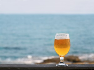 A beer on a table overlooking the sea. Do we know how much alcohol is safe?